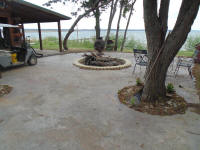 there is also a large concrete patiowith fire pit for Caney Point peoples to enjoy