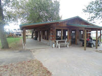 The pavilion is 24' x 40' log structure with plenty of tables